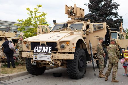 Indianapolis, Indiana, USA - August 16, 2019: National Guard Expo, Members of the National Guard displaying an Oshkosh M-ATV military vehicle to civilians