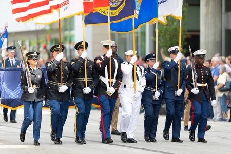 Indianapolis, Indiana, USA - May 25, 2019: Indy 500 Parade, Members of the United States military escorting the American flag down Pennsylvania Street