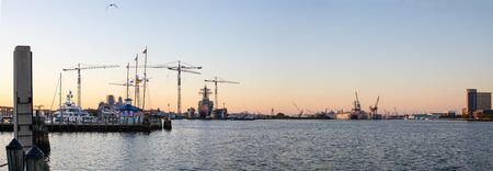 View of Elizabeth River with dry docks and warships of the US Navy in Norfolk Stock Photo