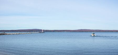View of Petoskey Harbor, with the Breakwater and lighthouse, in Michigan USA