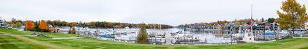 Charlevoix City Marina, Michigan, United States of America, View of the Round Lake waterfront during Autumn Stock Photo