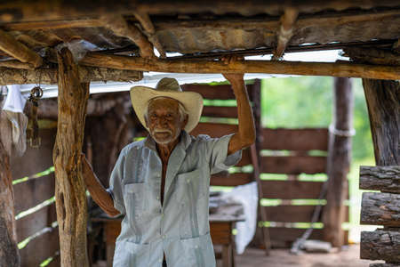 El Chorrito, Tamaulipas, Mexico, July 2, 2019: Mexican senior, welcomes town visitors into his humble home