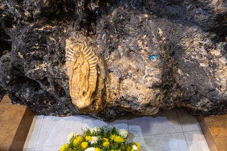 El Chorrito, Tamaulipas, Mexico, July 2, 2019: The Virgin del Chorrito, sculped into the stone, in a cave