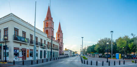 Matamoros, Tamaulipas, USA - November 20, 2019, View down Cinco street, at the Plaza Hidalgo, with view of the Cathedral