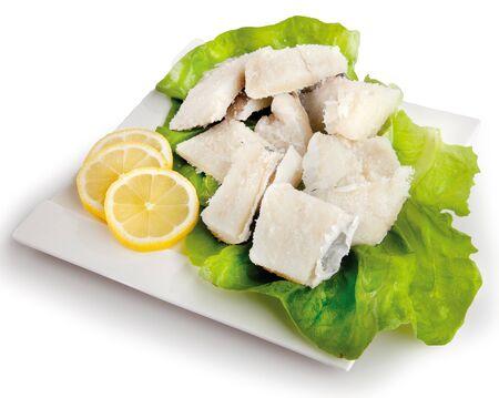 stockfish: stockfish fish composition, salad and lemon Stock Photo