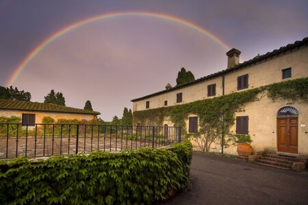 fraction: Querceto or Castle of Querceto is a fraction of the town of Montecatini Val di Cecina in the province of Pisa, located on the slopes of Mount Aneo, on a hilly outcrop overlooking the valley of Cecina and the Sterza river. View with rainbow