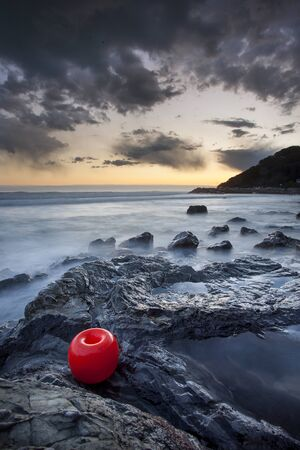 leghorn: Italy, Tuscany, Leghorn, Sunset with buoy over Fortullino Castiglioncello