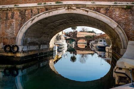 the merchant of venice: Livorno, The district of Venice (Quartiere Venezia) with its canals, bridges, merchant architectures