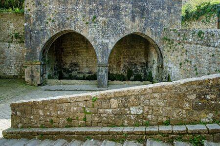 volterra: Italy, Tuscany, Volterra, Porta di Docciola door and his fountain Stock Photo