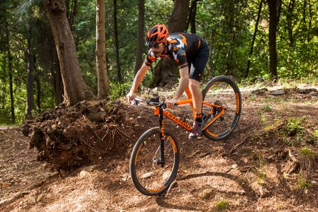 footwork: Bibbona, Tuscany, Italy - May 24, 2016: lifestyle using the mountain bike to ride in the paths of Tuscany and of the protected natural area of the Macchia Magona