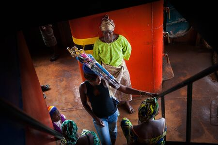 street vendor: Freetown, Sierra Leone - June 1, 2013: ferry to Freetown, street vendor of umbrellas