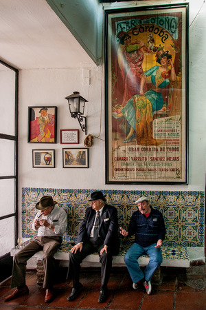 manifest: Cordoba or Cordova, is a city of Andalusia, southern Spain, entrance of a bar with a story of manifest of the Feria and bullfighting