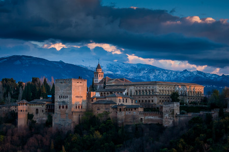 Granada, Spain - March 23, 2008 - view of Alhambra Palace in Granada, Spain with Sierra Nevada mountains at the background