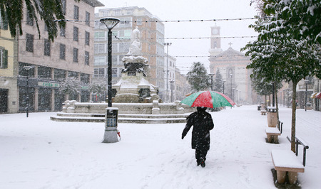 leghorn: Cecina, Livorno, Tuscany - snowfall in the city, Piazza Guerrazzi with the Town Hall, the church and the fountain of Maremma Thirsty