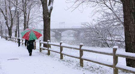 Cecina, Livorno, Tuscany - snowfall in the city, the bridge on the river Cecina and the walkside Stock Photo