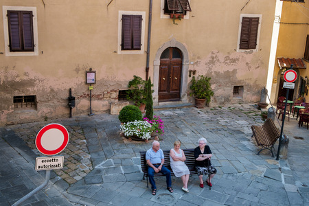 vigil: Lari in the municipality of Casciana Terme in the province of Pisa is important for its Castello dei Vicari, Vicari Castle, seniors shade are in vigil for shelter from the heat of summer