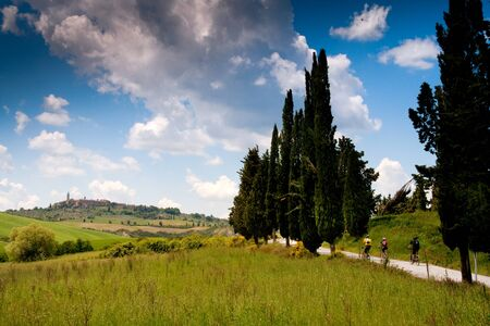 Val dOrcia, Siena, mountain bike excursion in the Tuscan hills - municipal road San Regolo at Podere Casa al Piano, on background Pienza Stock Photo