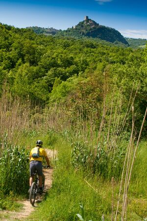 Val dOrcia, Siena, mountain bike excursion in the Tuscan hills - path to the ford of Mulina in Bagno Vignoni, in the background Rocca dOrcia