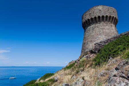 tyrrhenian: Capraia Island, Arcipelago Toscano National Park, Tuscany, Italy - the tower of the port with sea views