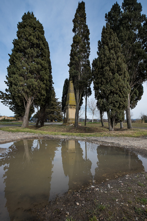 Bolgheri, Leghorn - Obelisk in memory of the poet Carducci in San Guido near famous cypress avenue, Tuscany, Italy