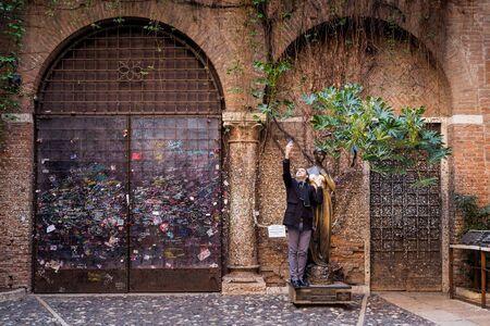 VERONA, Italy - April 04, 2017: Selfie of tourist near Juliet and balcony house, Verona, Italy Editorial