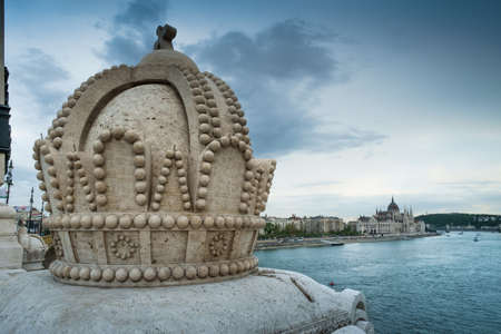 afterglow: Budapest, Hungary - The Holy Crown on the Margherita Bridge, on background The Parliament Editorial