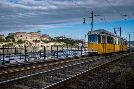 Budapest, capital of Hungary, the legendary tram two - circulates the Pest side of the Danube with a view of the Palace of Budapest Editorial