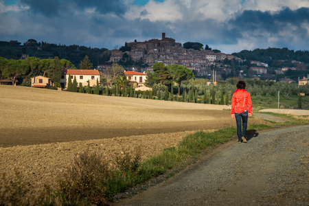 Casale Marittimo, Pisa, Italy - November 23, 2017: Trekking route towards the medieval village in Casale M.mo, in the Province of Pisa, along the beautiful views and hills typical of Tuscany