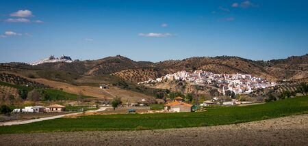 Setenil de las Bodegas, Cadiz province, Andalusia, Spain, a famous village de la Ruta de los Pueblos Blancos, white villages, between Cadiz and Malaga, the countryside a few kilometers from Setenil, on background Olvera Stock Photo