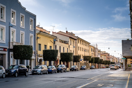 CECINA, TUSCANY, ITALY - March 31, 2018: the Via Aurelia main street of the city that crosses the city connecting Livorno and Grosseto