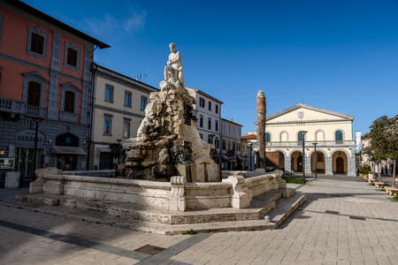 CECINA, TUSCANY, ITALY - March 31, 2018: Piazza Francesco Domenico Guerrazzi with the fountain of the Maremma Assetata created by the artist Emidio Vignali in 1919. The work represents Hercules that overshadows and dominates the Muses of bronze, in the ba Redakční