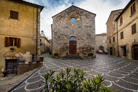 Bibbona, Leghorn, Italy - April 2018 the medieval village of Bibbona in Tuscany, the parish church of Sant'Ilario is a sacred building located in Piazza XX Settembre in Bibbona Redakční