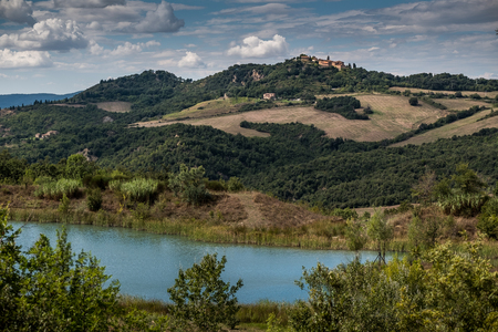 Mensano, Siena, Tuscany - fraction of the Italian town of Casole dElsa, in the province of Siena, in Tuscany, panoramic view from the hill with cypress trees 版權商用圖片