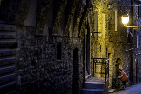 MONTEMERANO, GROSSETO, ITALY - JULY 29, 2018: Unknown woman, Montemerano, Tuscany - small medieval village inMaremma. Montemeranois a 12th century town in the heart of Maremma, at 55 kilometers from Grosseto, Italy Editorial