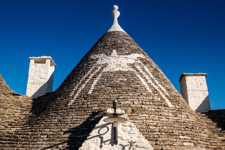 Trulli domes, traditional houses built with dry stone and conical roof, Alberobello,  Valle Itria, small town close to Bari district in Southern Italy, Puglia, Apulia, Italy, Europe