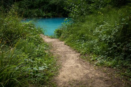 Alta Val d'Elsa river park, the trail starts in Gracciano and reaches in Colle Val d'Elsa (Siena, Tuscany) the river's waters are clear and of an intense turquoise color and are part of a protected natural area Stock Photo