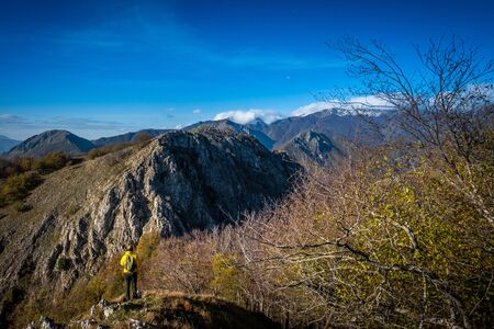 Descent from the Pen to the Saddle of the Romitorio between Penna di Lucchio and Monte Memoriante with the autumn colors, walking along the Lucchese Apennines, Lucca - Tuscany, Italy 写真素材