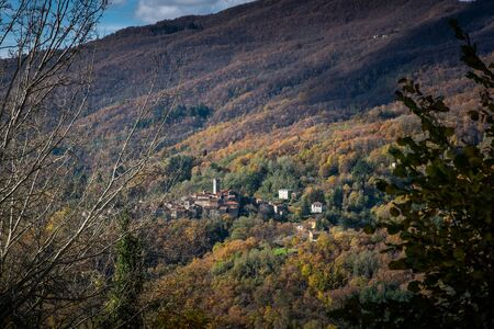 Excursion walking along the Lucchese Apennines, view of the town of Stiappa from the village of Pontito with Monte Battifolle in the background, Lucca . Tuscany, Italy 写真素材