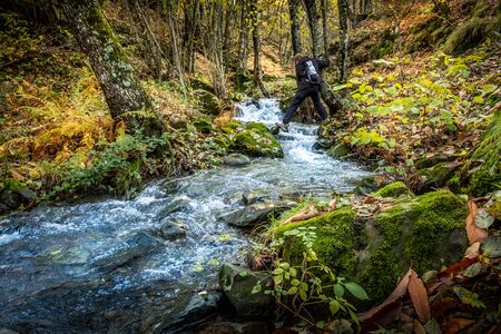 Path from Pontito leads to the Croce a Veglia with the Pescia stream of crystal clear water, walking along the Lucchese Apennines  to the Penna of Lucchio, Lucca, Tuscany - Italy 写真素材