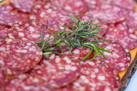 Processed foods for aperitifs, tuscan pork salami with rosemary compounds and preparations for tastings