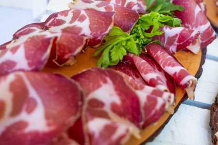 Processed foods for aperitifs, sliced pork with pieces of celery compounds and preparations for tastings