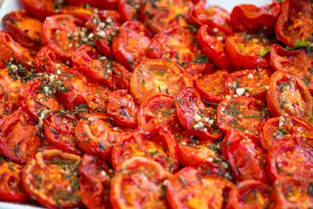 Processed foods for aperitifs, baked tomatoes au gratin compounds and preparations for tastings