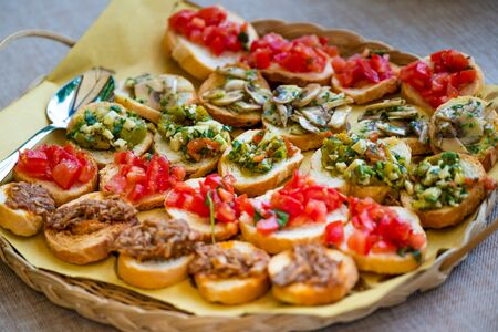 Processed foods for aperitifs, various kinds of croutons with mushroom tomatoes and meat compounds and preparations for tastings