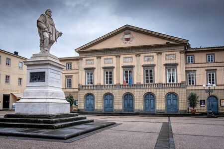 Lucca - the statue dedicated to Giuseppe Garibaldi Italian national hero in Piazza of Giglio which gives its name to the theater in the background, Tuscany, Italy