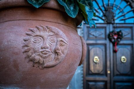 Terracotta vase with the representation of the sun and moon in the Gugliemi square in Montalto di Castro enclosed between the coasts of the Tyrrhenian sea, the waters of the Fiora river and the countryside of the Maremma Latium