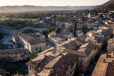 Panoramic view from the loggia of the Palazzo dei Consoli in the historic center of Gubbio, medieval town in Umbria in the province of Perugia, central Italy Фото со стока