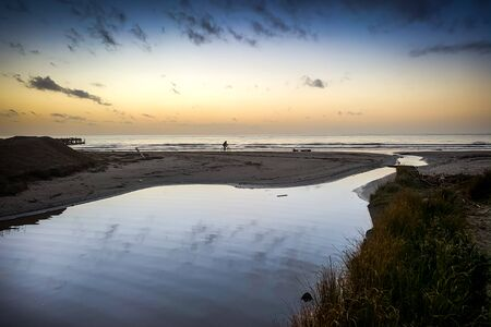 Sunset on the beaches of Vada seaside resort town in the province of Livorno on the Etruscan Coast, Tuscany, Italy