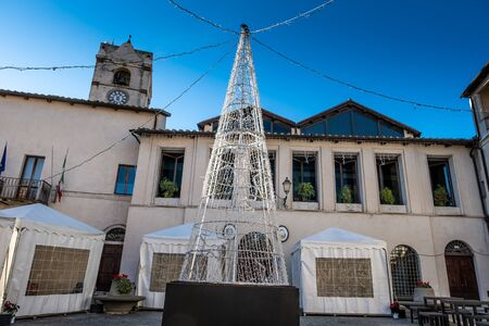 The square with the seat of the municipality decorated for the Christmas holidays in Montalto di Castro enclosed between the coasts of the Tyrrhenian sea, the waters of the Fiora river and the countryside of the Maremma Latium