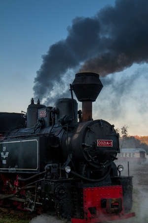 VISEUS DE SUS, ROMANIA - OCTOBER 10, 2014: Mocanita, a steam locomotive fueled by a wood fire, has Viseu de Sus as its starting point and runs for about 60 km to the border with Ukraine crossing the Maramures. Romania, Europe Editoriali