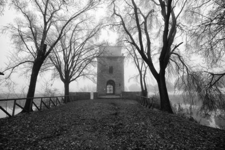Old building in the fog. Italy. Black and white image.